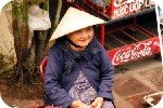 Woman outside shop in Hoi An